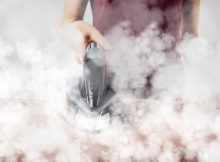 how to use a steamer to iron clothes
